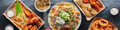 Sticker top down photo of carne asada fries and buffalo chicklen wings