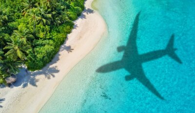 Sticker Travel concept with airplane shadow and beach