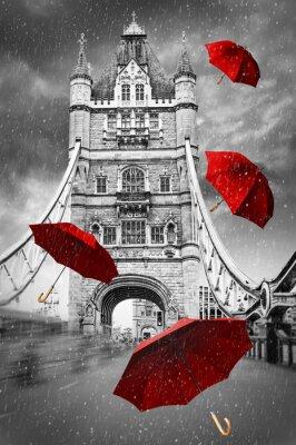 Turm-Brücke auf der Themse mit fliegenden Regenschirmen. London, England. Schwarzweiss-Konzeptgraphik mit rotem Element.