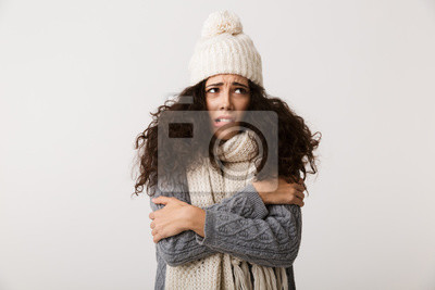 Sticker Upset young woman wearing winter scarf