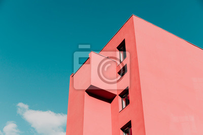 Sticker View from below on a pink modern house and sky. Vintage pastel colors, minimalist concept.