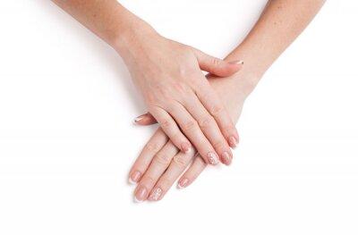 Weibliche Hände mit schöner Maniküre auf einem weißen Hintergrund. Nahansicht