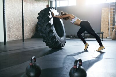 Sticker Weight Lifting. Sportswoman Training With Crossfit Wheel At Gym