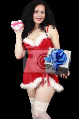 Weihnachts sinnliche Brünette Mädchen mit Geschenken, sexy gekleidet