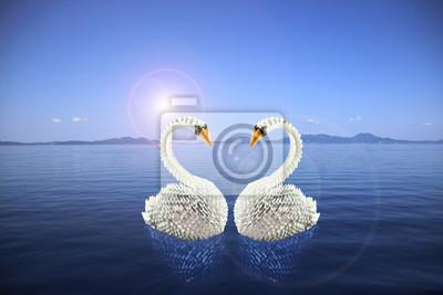 Weiße Schwäne Origami in der Liebe auf dem Meer machen ein Herz