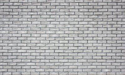 Weißer Wandhintergrund des alten Schmutzziegelsteines