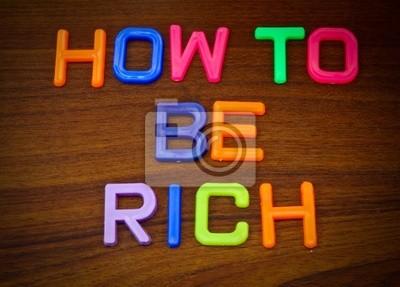 Wie reich zu sein in bunten Spielzeug Buchstaben auf Holz Hintergrund