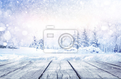 Sticker Winter christmas scenic landscape with copy space. Wooden flooring strewn with snow in forest  with fir-trees covered with snow on nature.