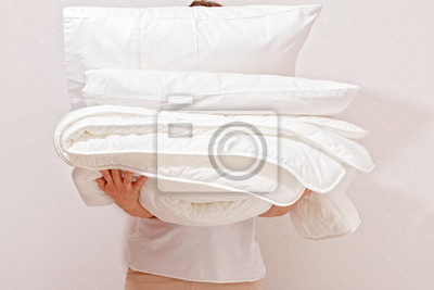 Sticker Woman holding a pile of bedding for sleeping. Household