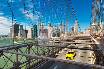 Yellow taxi on the Brooklyn Bridge, New York
