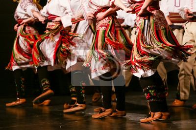 Sticker Young Serbian dancers in traditional costume. Folklore of Serbia