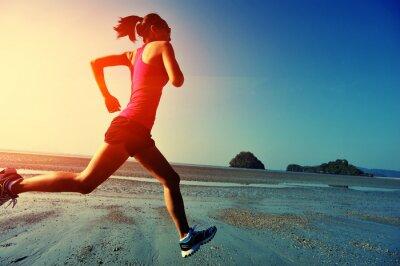Sticker young woman running on sunrise beach