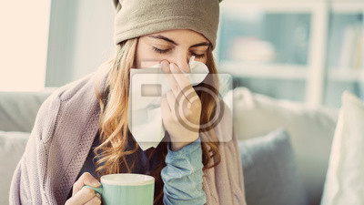 Sticker Young woman suffering from cold