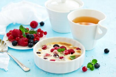 Zabaglione with champagne and berries. French dessert.